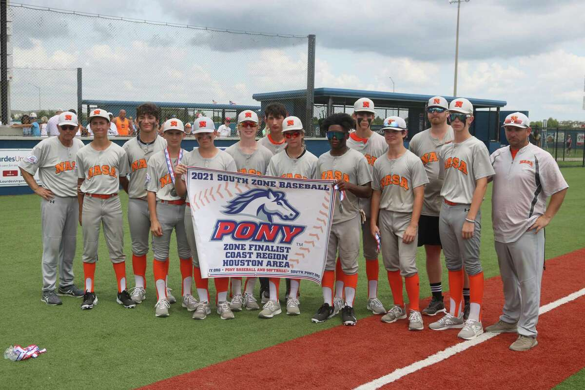 A somber NASA Orange contingent poses with its runner-up banner, following their numbing loss in the South Zone title game.