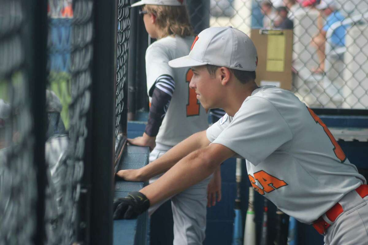 NASA Orange's Thomas Myers watches the South Zone championship game action during the first inning.
