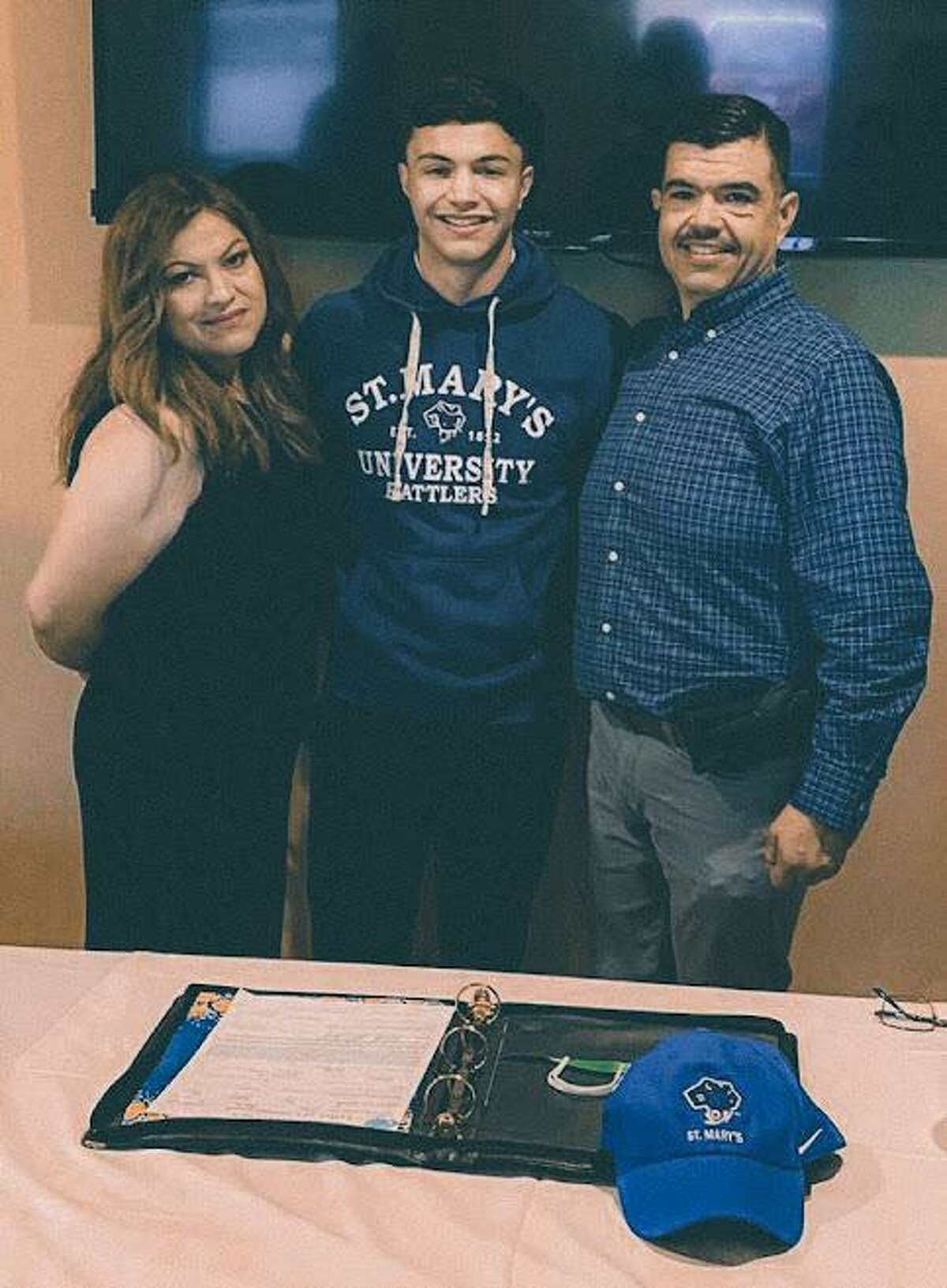 """Laredo Heat SC goalkeeper Roberto """"Tito"""" Ortiz is pictured with his parents at Palenque Grill on Wednesday, July 28 after committing to play at St. Mary's."""