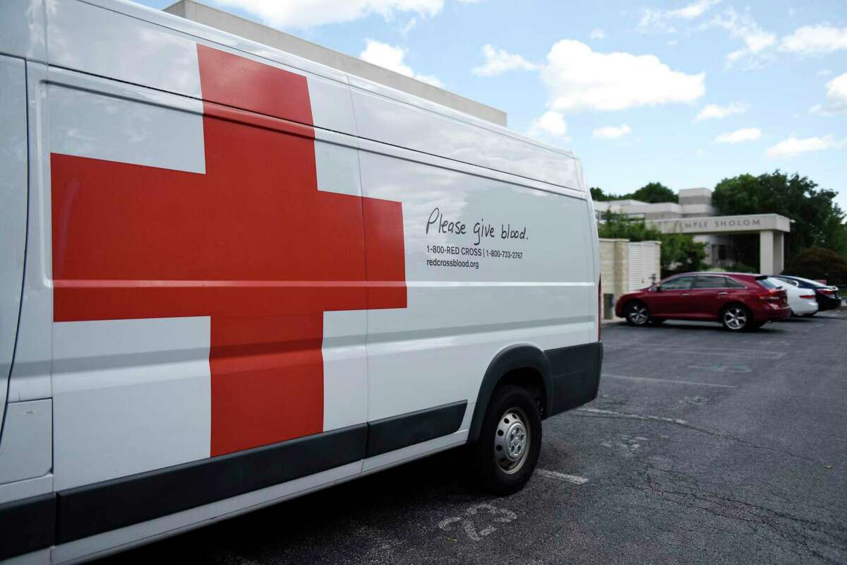Vans are parked outside the American Red Cross blood drive at Temple Sholom in Greenwich, Conn. Monday, Aug. 2, 2021. Considering COVID-19 precautions, blood donation appointments must now be booked in advance online, by calling 1-800-RED-CROSS, or using the American Red Cross app. The next American Red Cross blood drive in Greenwich will be at First Presbyterian Church on Aug. 20.