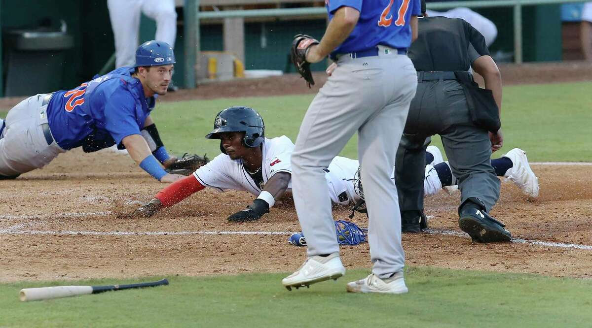 The Missions' Esteury Ruiz dives home for a score against Midland RockHounds catcher Collin Theroux in the third inning at Wolff Stadium on Tuesday, June 8, 2021.
