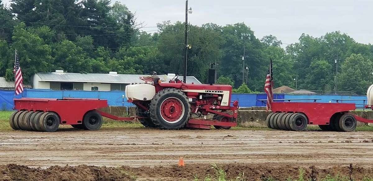 The West Michigan Pullers were at the Eaton County Fair in Charlotte in July. The group will host atractor pull event starting at 7 p.m. on Aug. 20 in the grand stands at the Manistee County Fairgrounds in Onekama. (Courtesy photo)