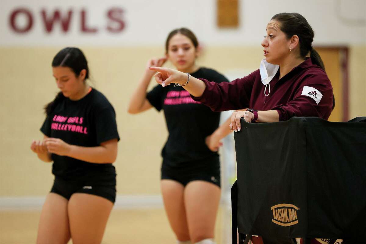 Highlands' volleyball coach Desiree Lara works with the Lady Owls in the school's gym during their first day of fall practice on Monday, Aug. 2, 2021.