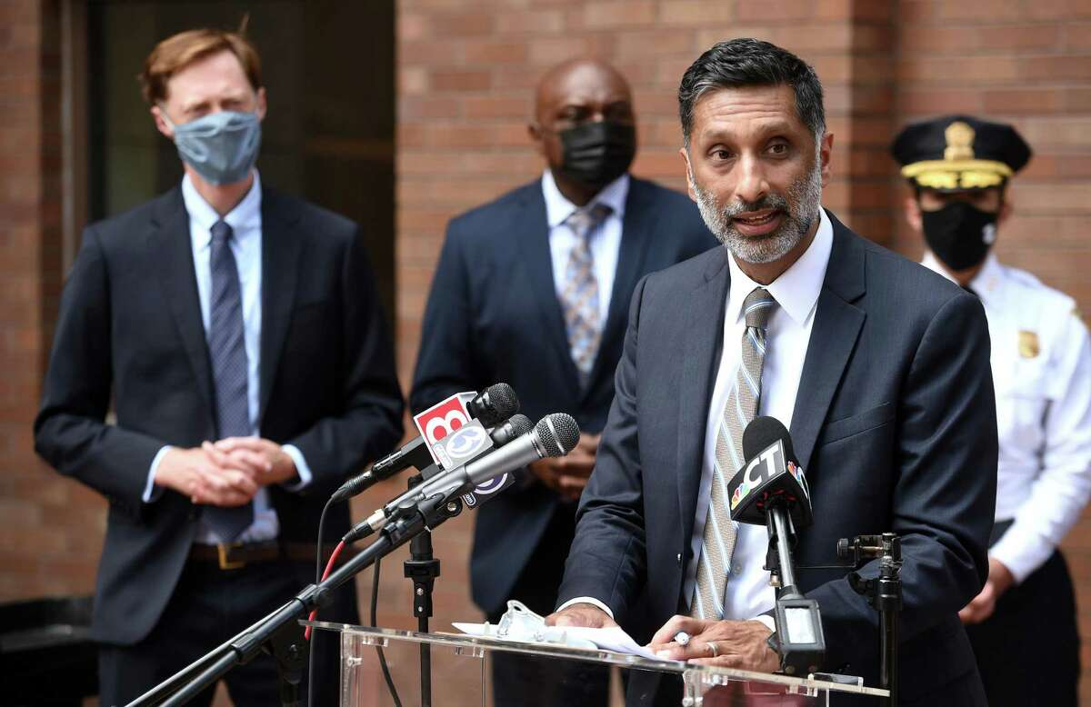 New Haven Community Services Administrator Dr. Mehul Dalal, right, speaks at a press conference announcing a proposed new city department, the Department of Community Resilience, outside of City Hall in New Haven Aug. 2, 2021.