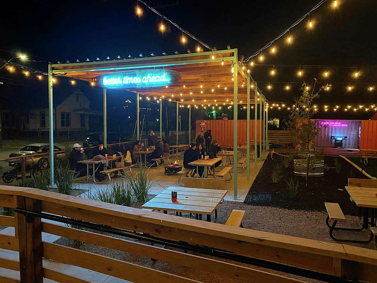 """The courtyard neon promises """"better times ahead"""" at Thai restaurant and tiki-inspired bar Hello Paradise, situated at the former Shuck Shack on Grayson Street in San Antonio."""