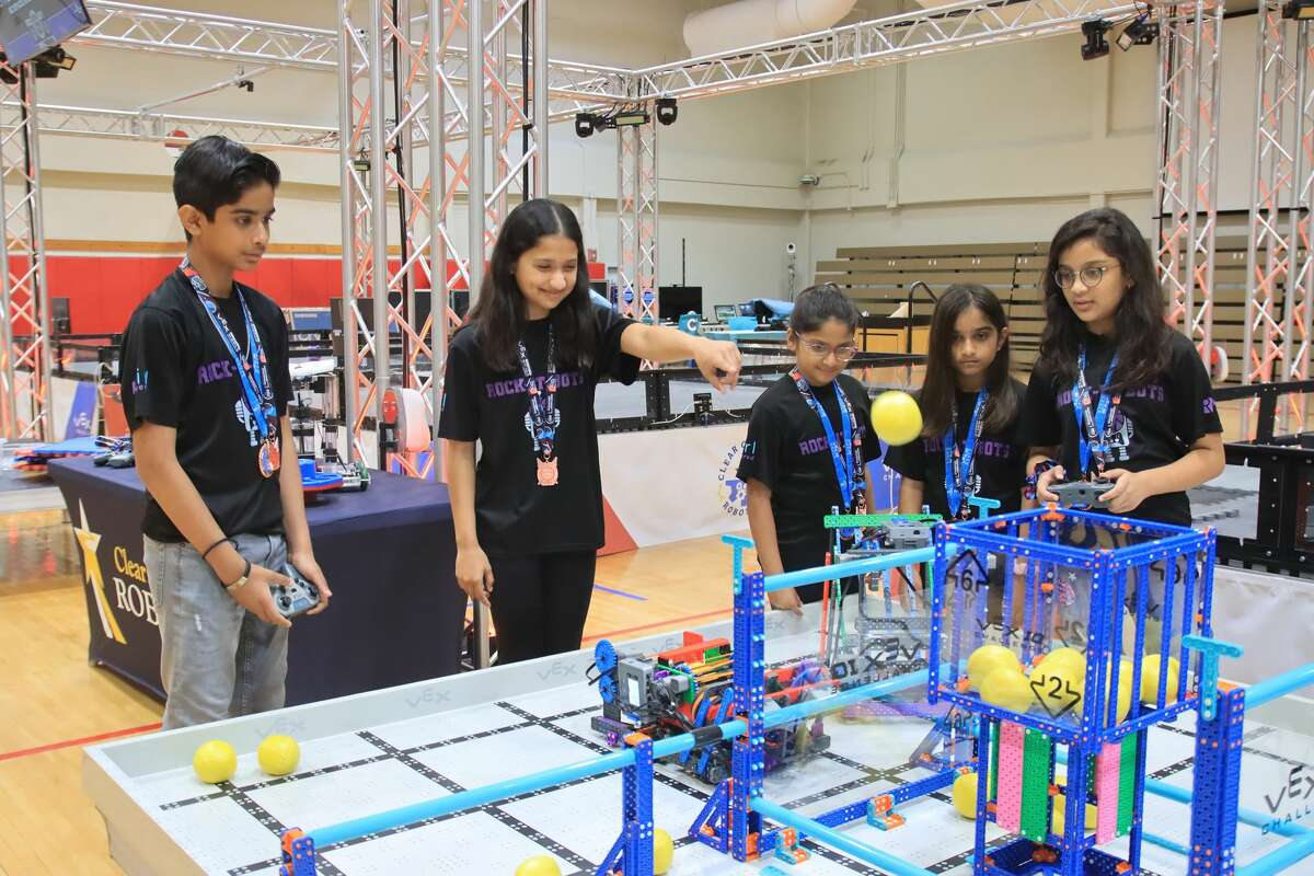 Members of a world champion robotics team from Clear Creek ISD have fun in the district's robotics center, which is scheduled to be completed this fall. The district is planning a program for elementary schools that will incorporate robotics and coding into the curriculum.