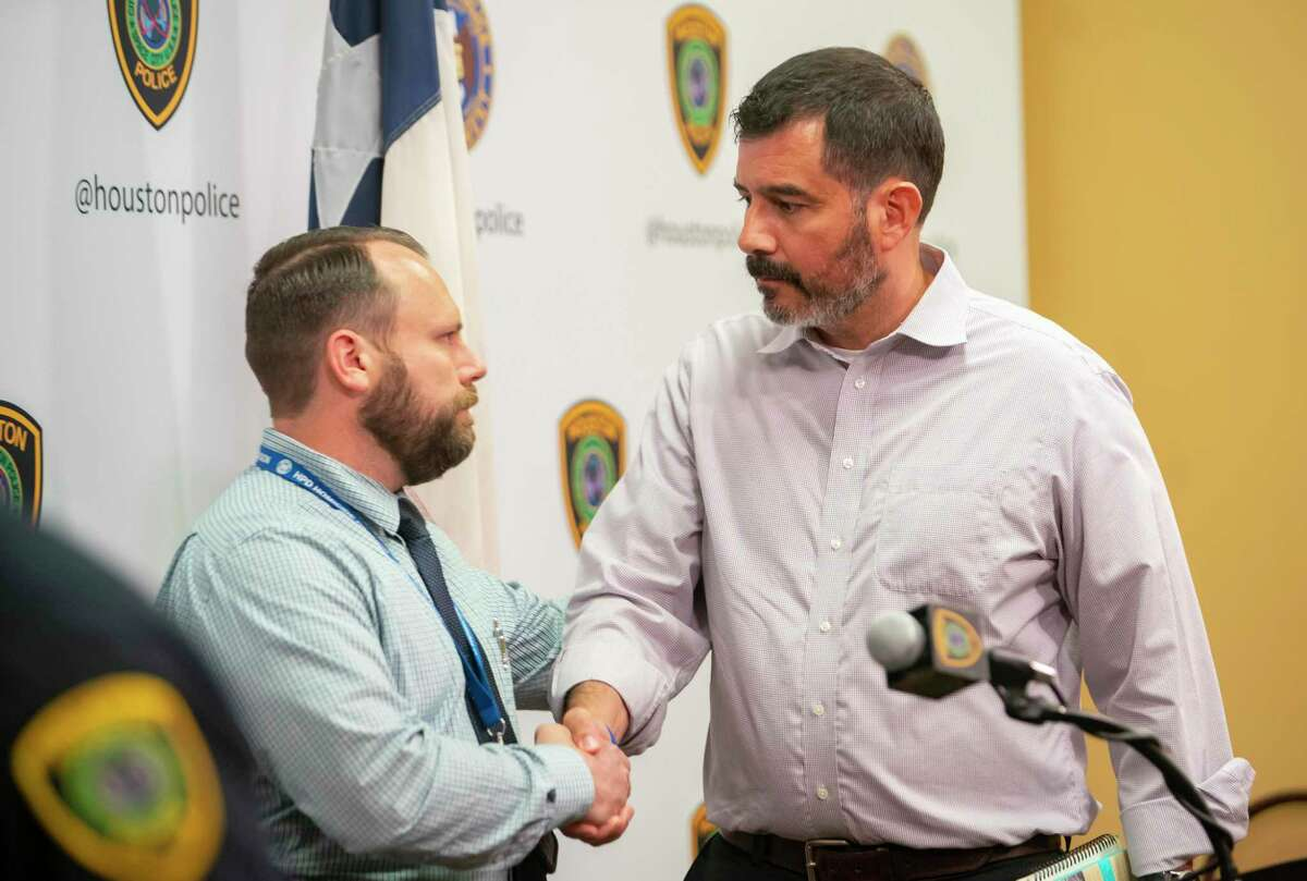 Paul Castro, right, shakes hands with Detective Justin Brown following a press conference announcing the arrest of Gerald Williams, 34, who was wanted on a murder charge for the death of Castro's son, 17-year-old David Castro last month, following the press conference at HPD headquarters, Monday, Aug. 2, 2021, in downtown Houston. Castro was killed July 6 during a road rage incident that belong after an Astros game and extended onto Interstate 10.