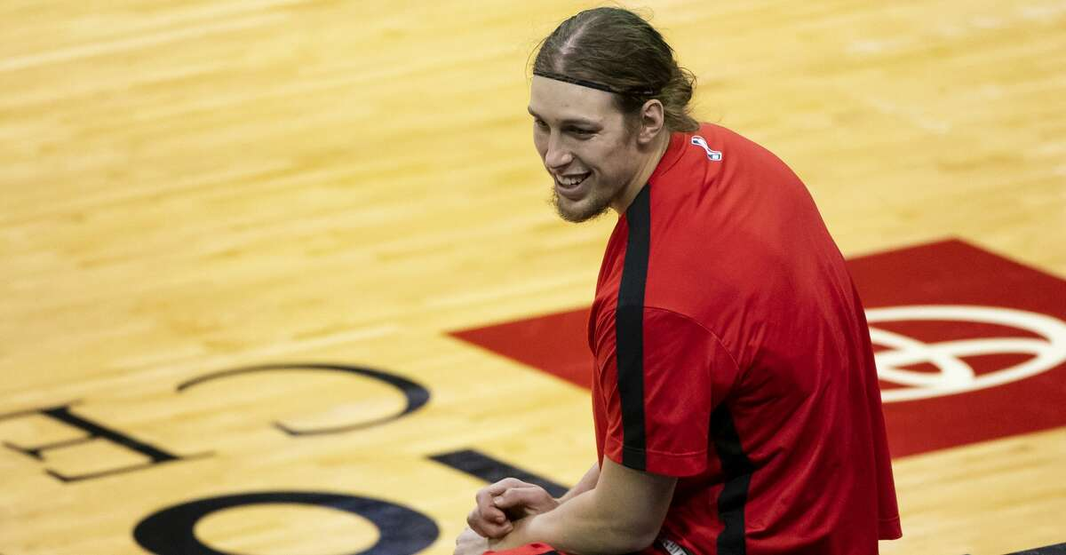 Houston Rockets forward Kelly Olynyk (41) talks at the scorer's table during the first quarter of an NBA game between the Houston Rockets and Minnesota Timberwolves on Tuesday, April 27, 2021, at Toyota Center in Houston.