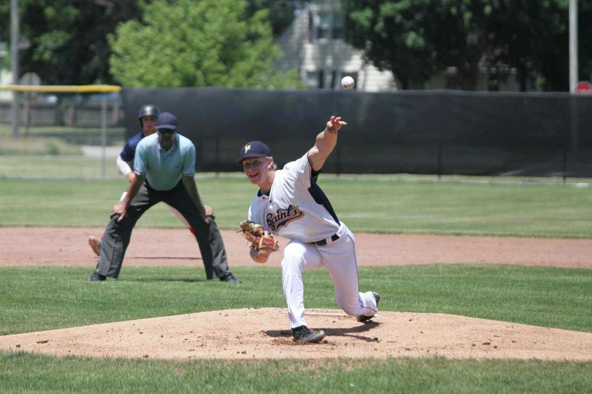 Saints pitcher Sam Schmitt fires a pitch during a regular season game at Rietz Park in Manistee. The Saints qualified for the National Amateur Baseball Federation World Series tournament with a win at an NABF regional tournament in Pinconning over the weekend. (File photo)