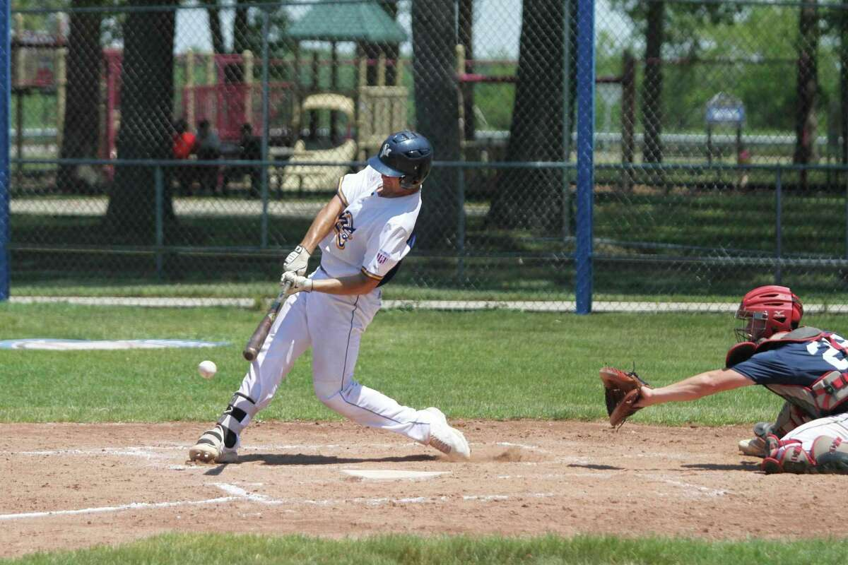 Manistee's JakePaganelli puts the ball in play during a regular season game at Rietz Park in Manistee. The Saints open the National Amateur Baseball Federation World Series tournament against theNorth Jersey Sox in Battle Creekon Thursday. (File photo)