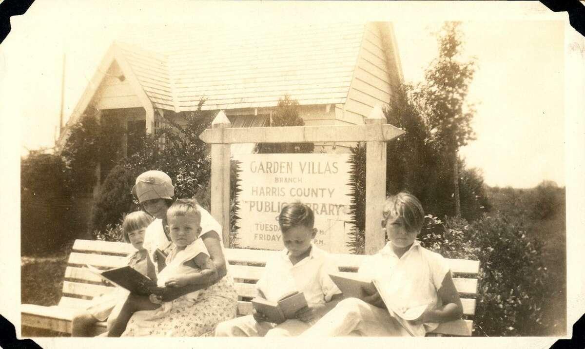 Children enjoy a outdoor reading area at a Harris County Public Library garden villa from the 1930s.