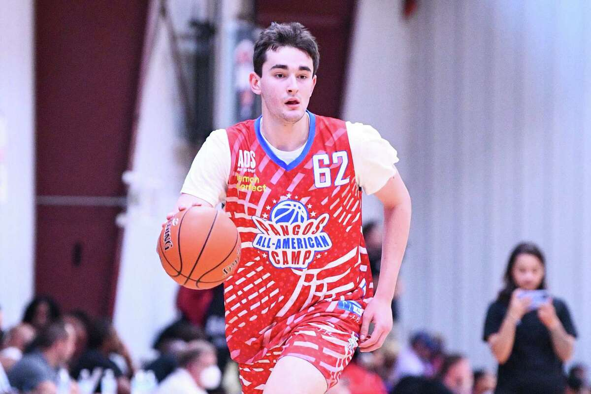 Alex Karaban dribbles up the court during the Pangos All-American Camp on June 7 at the Tarkanian Basketball Academy in Las Vegas. Karaban, a 6-foot-8, 210-pound forward from IMG Academy in Bradenton, Florida announced his commitment to UConn on Monday.