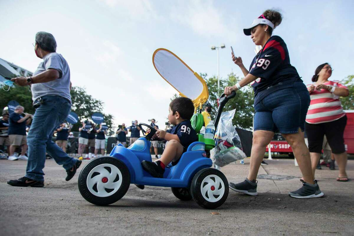Houston Texans fans arrive to watch an NFL training camp football practice Monday, Aug. 2, 2021, in Houston.