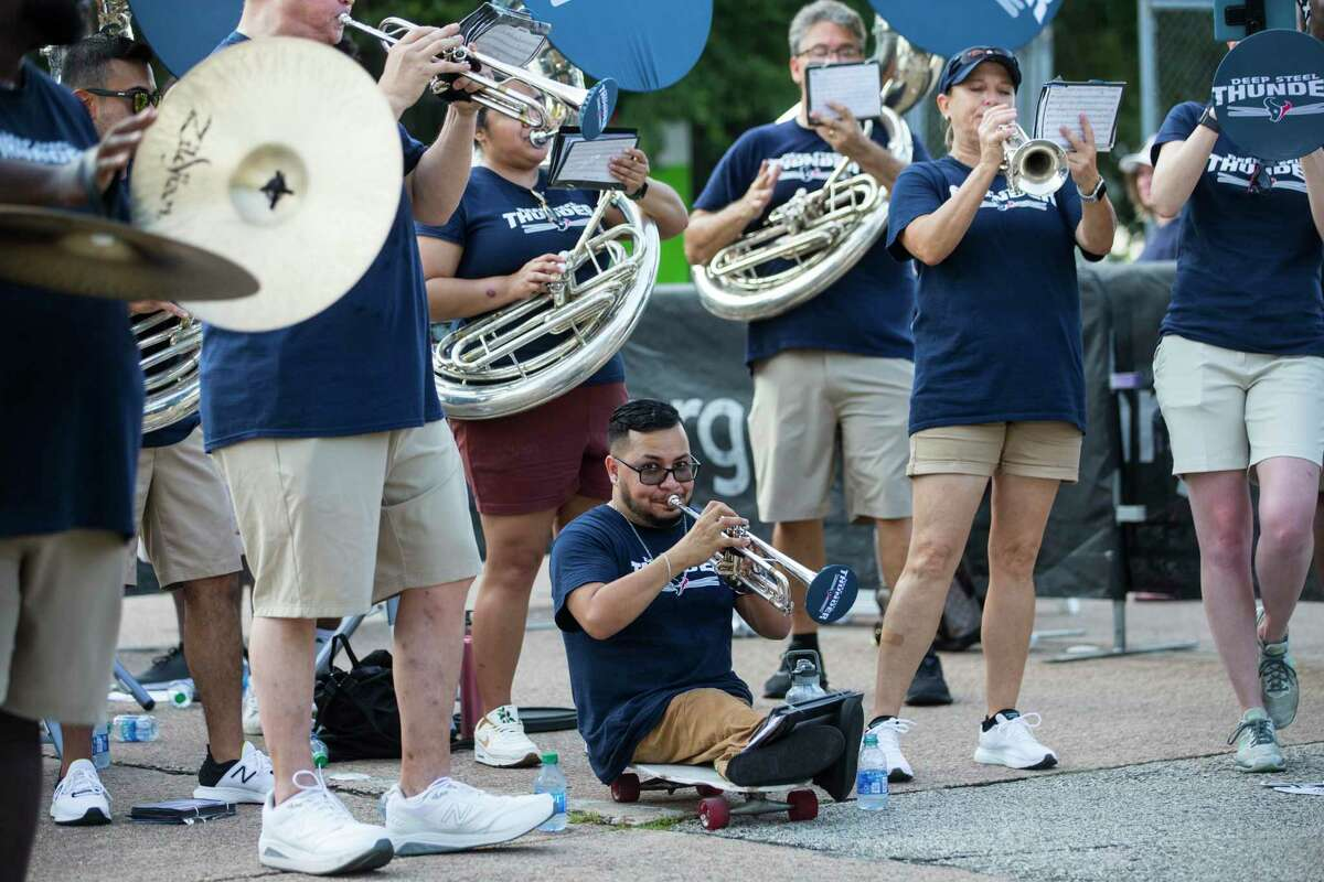 The Houston Texans Deep Steel Thunder pep band plays for fans during an NFL training camp football practice Monday, Aug. 2, 2021, in Houston.