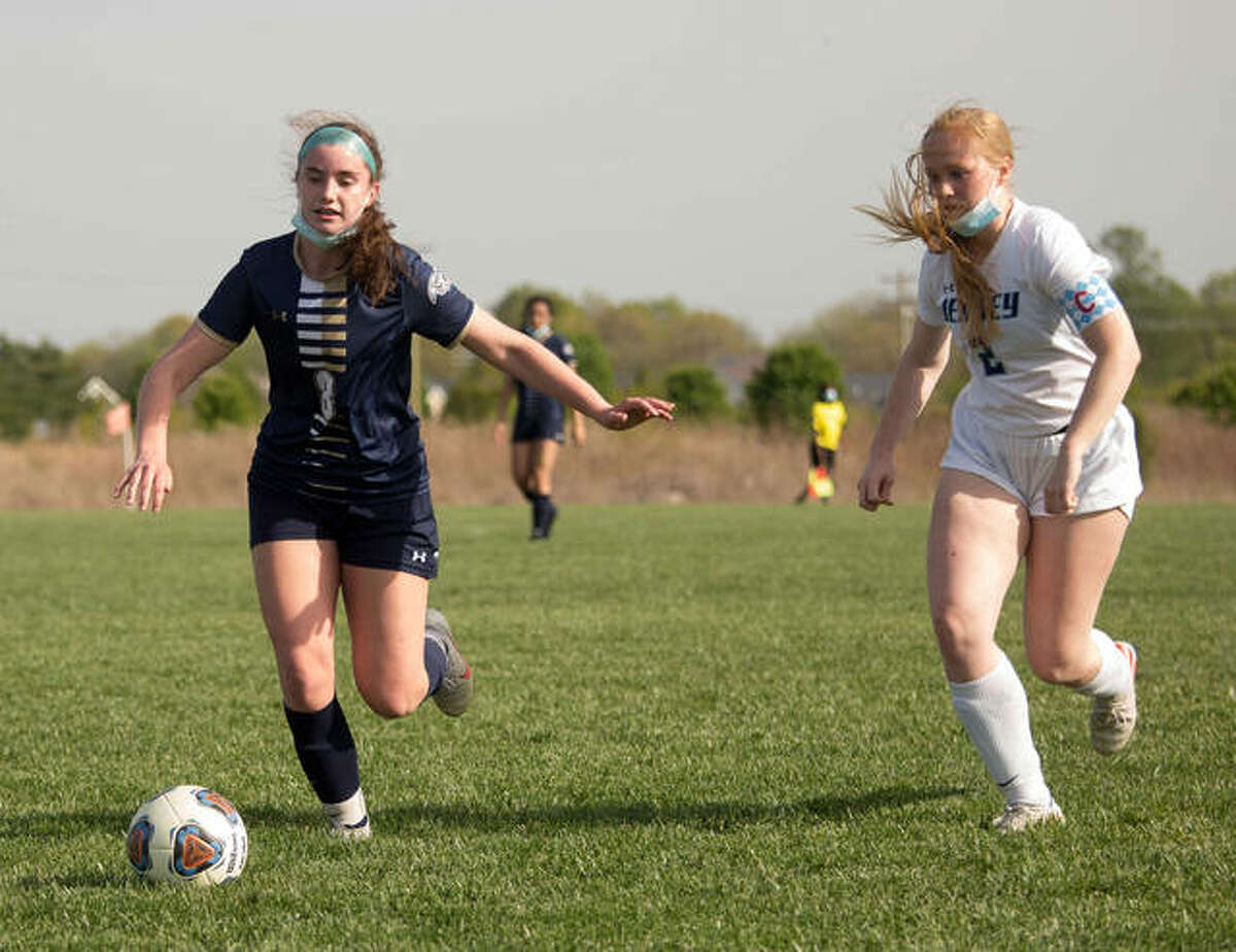 Father McGivney's Adelyn Speight, left, controls the ball during a game against Jerseyville.