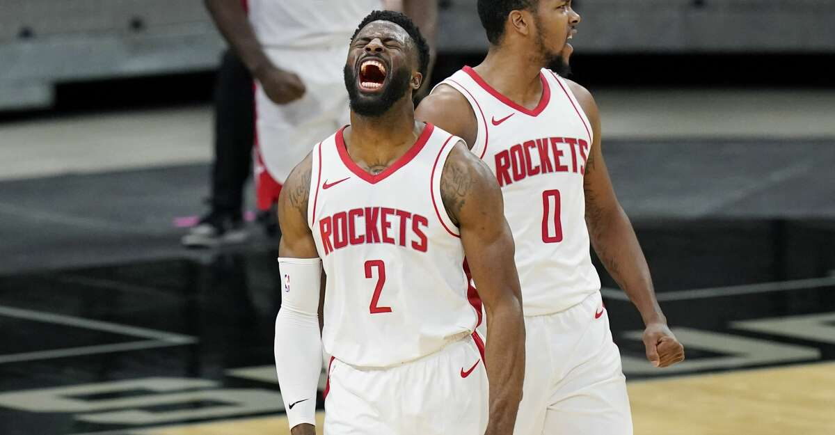 Houston Rockets forward David Nwaba (2) and guard Sterling Brown (0) celebrate their win over the San Antonio Spurs in an NBA basketball game in San Antonio, Thursday, Jan. 14, 2021. (AP Photo/Eric Gay)