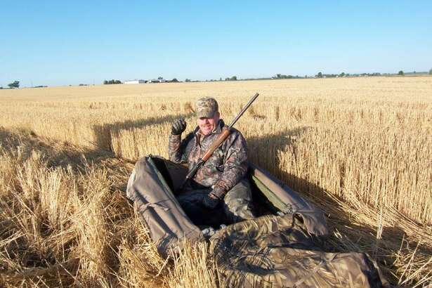 Randy Severance of Decker taking a break in his layout blind during a September Early Goose Season in a Thumb wheat-stubble field.