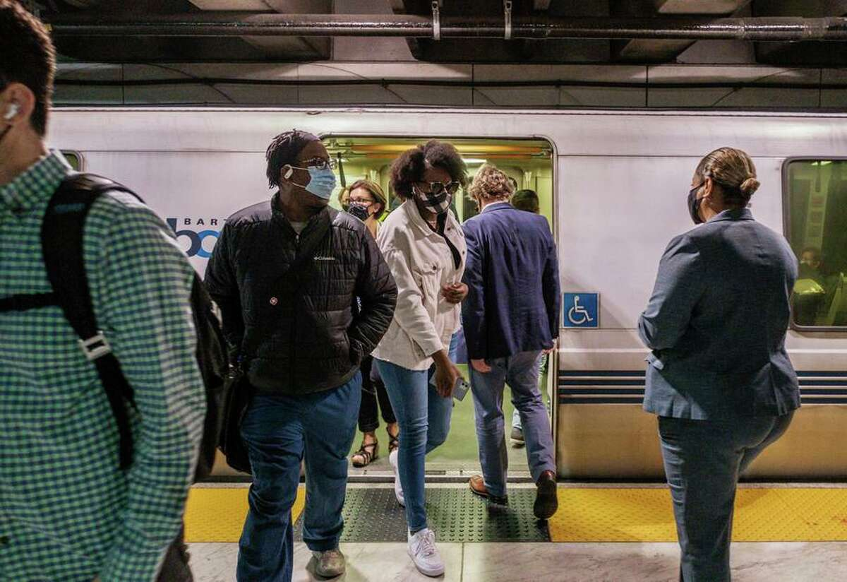BART GM Bob Powers is seen entering a BART train with other riders in San Francisco on Monday.
