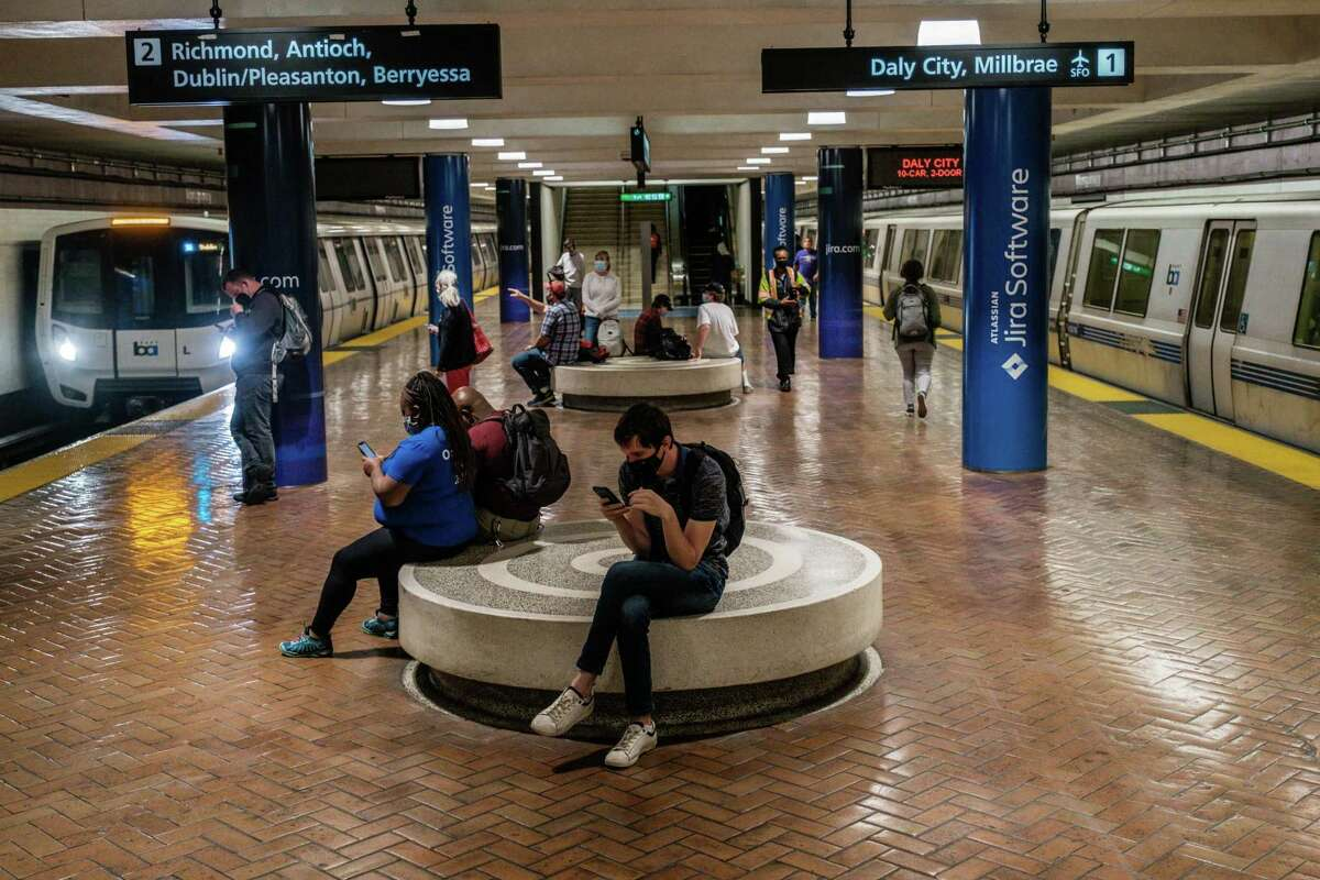 Riders are seen waiting for trains at the Montgomery Street BART Station in San Francisco on Monday.