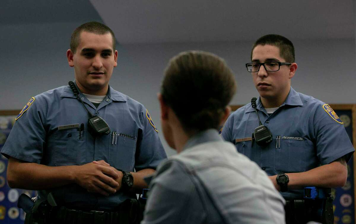 Then-San Antonio Police Academy Cadets Andres Rivera, left, and Domingo Rios participated in a role-playing exercise in September 2019 as part of a weeklong crisis intervention training at the San Antonio Police Training Academy on identifying signs of mental illness or addiction and deescalating tense situations.