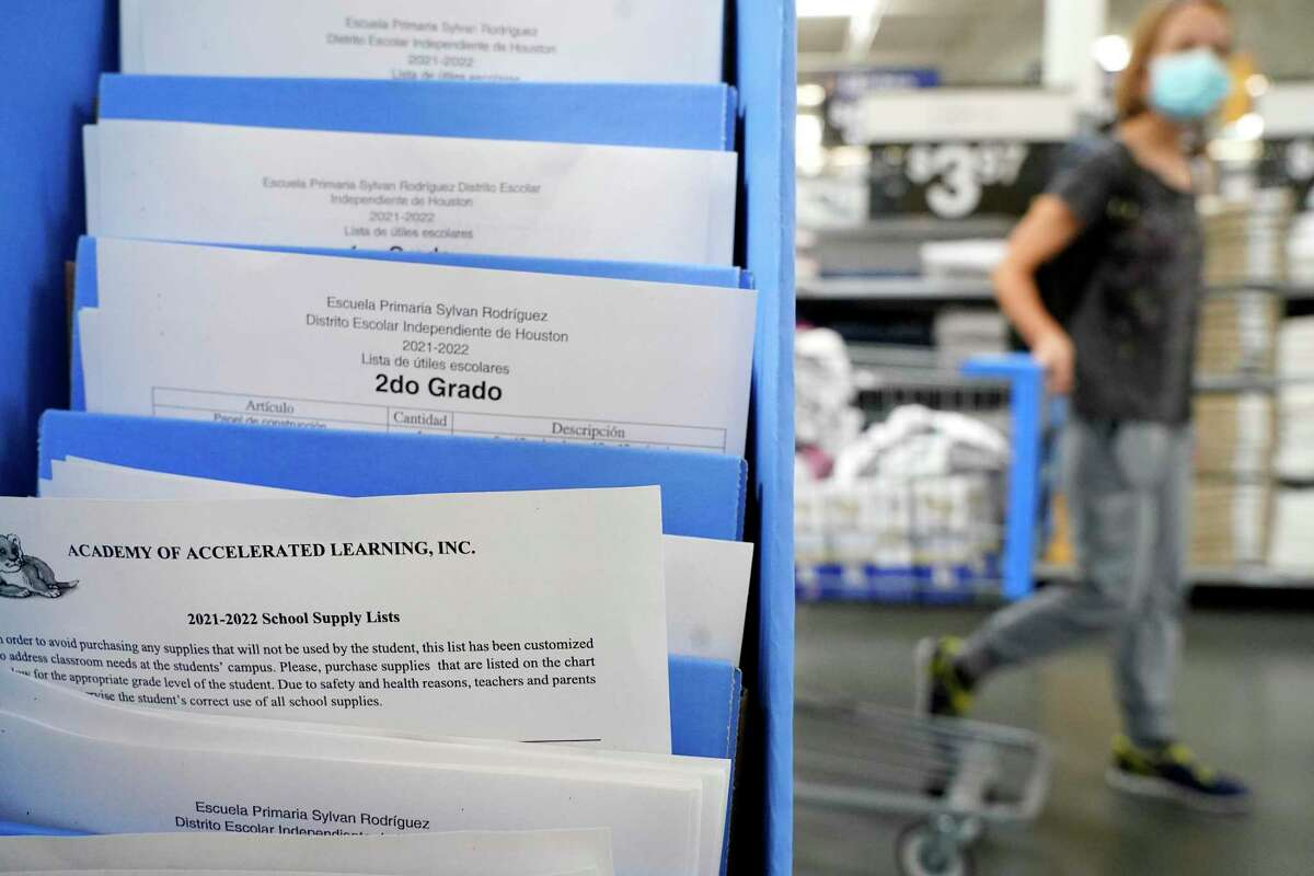 Supply lists for schools are displayed among the school supplies at Walmart, 5405 South Rice, Friday, July 30, 2021 in Houston.