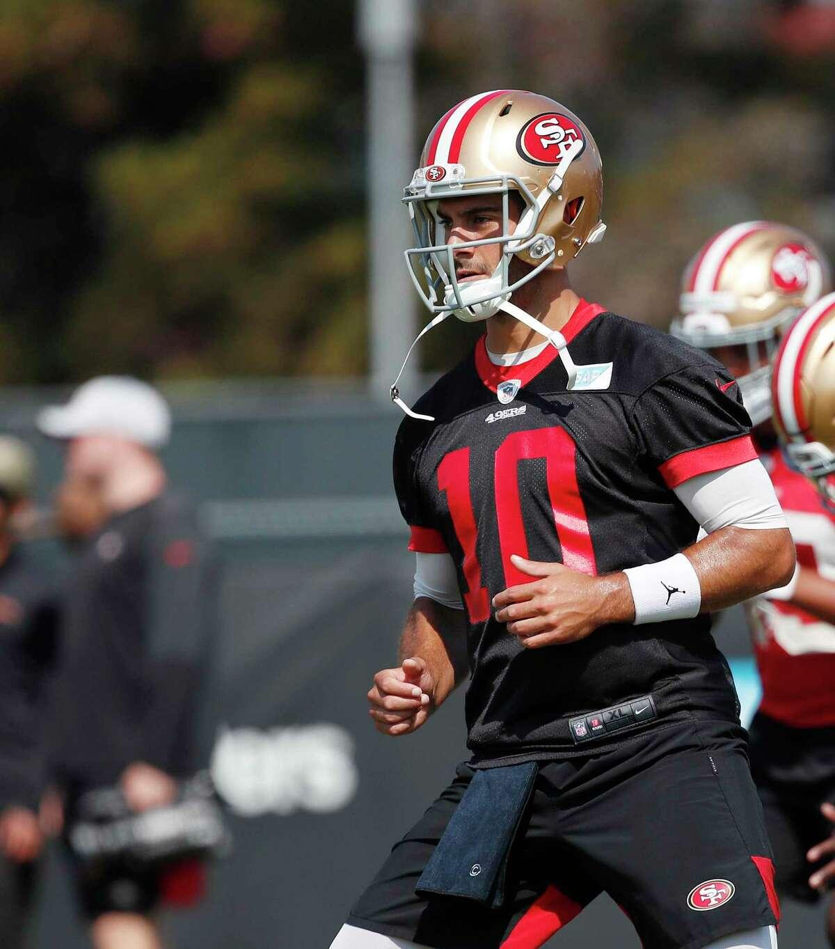 San Francisco 49ers quarterback Jimmy Garoppolo works out during an NFL football training camp in Santa Clara, Calif., Saturday, July 31, 2021. (AP Photo/Josie Lepe)