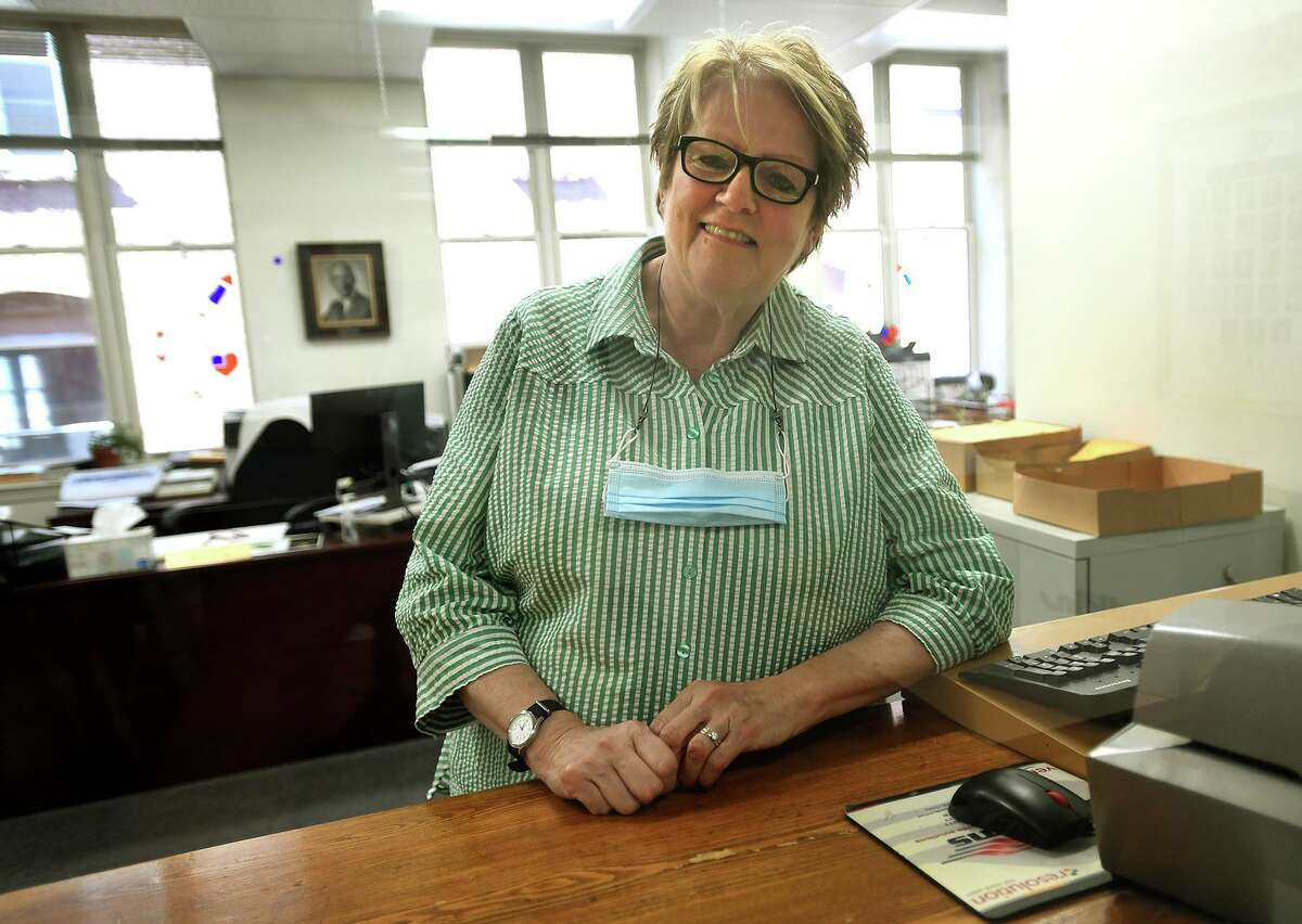 Town Clerk Beth Lynch welcomes the public to the reopening of Ansonia City Hall in Ansonia, Conn. on Monday, August 2, 2021.