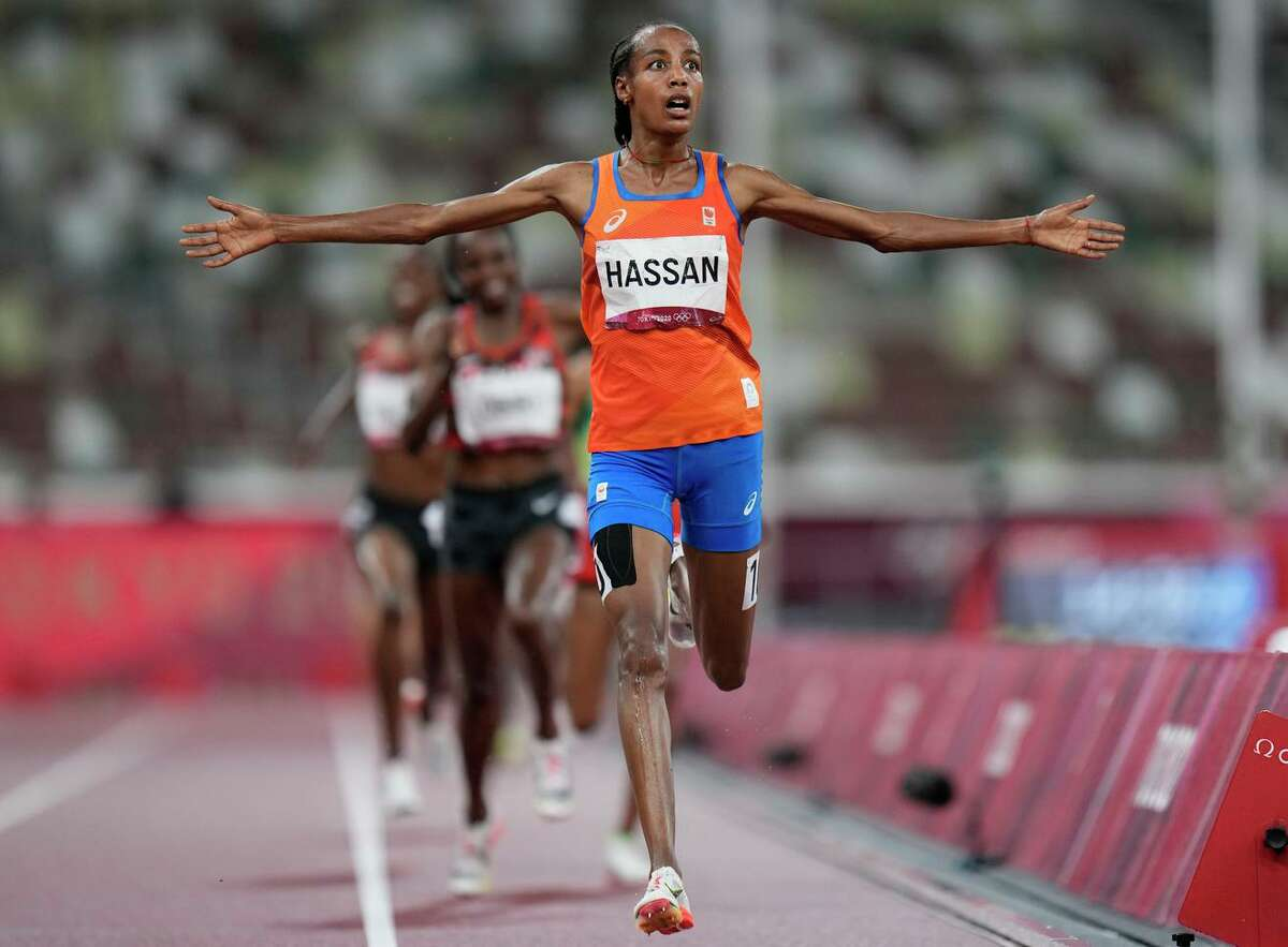 Sifan Hassan of the Netherlands crosses the finish line to win the women's 5,000 meters at the Tokyo Olympics. It capped a long day after she won her first heat in the 1,500 meters.