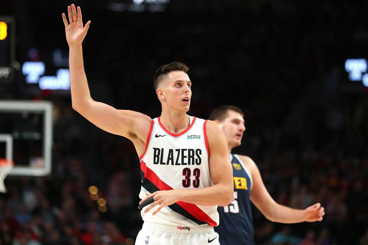 PORTLAND, OREGON - OCTOBER 23: Zach Collins #33 of the Portland Trail Blazers reacts against the Denver Nuggets in the third quarter during their season opener at Moda Center on October 23, 2019 in Portland, Oregon. NOTE TO USER: User expressly acknowledges and agrees that, by downloading and or using this photograph, User is consenting to the terms and conditions of the Getty Images License Agreement (Photo by Abbie Parr/Getty Images)