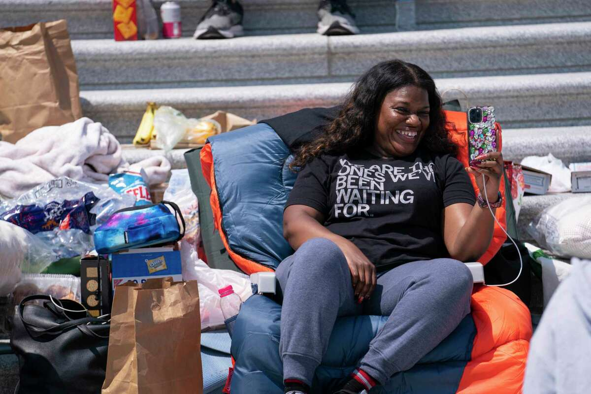 Rep. Cori Bush, D-Mo., protests the expiration of the eviction moratorium on the Capitol steps Saturday.