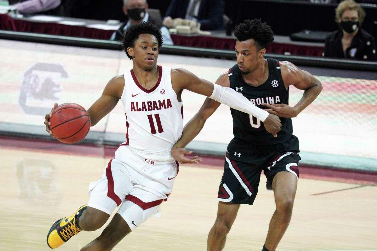 In this Feb. 9, 2021 photo, Alabama guard Joshua Primo drives against South Carolina guard AJ Lawson.
