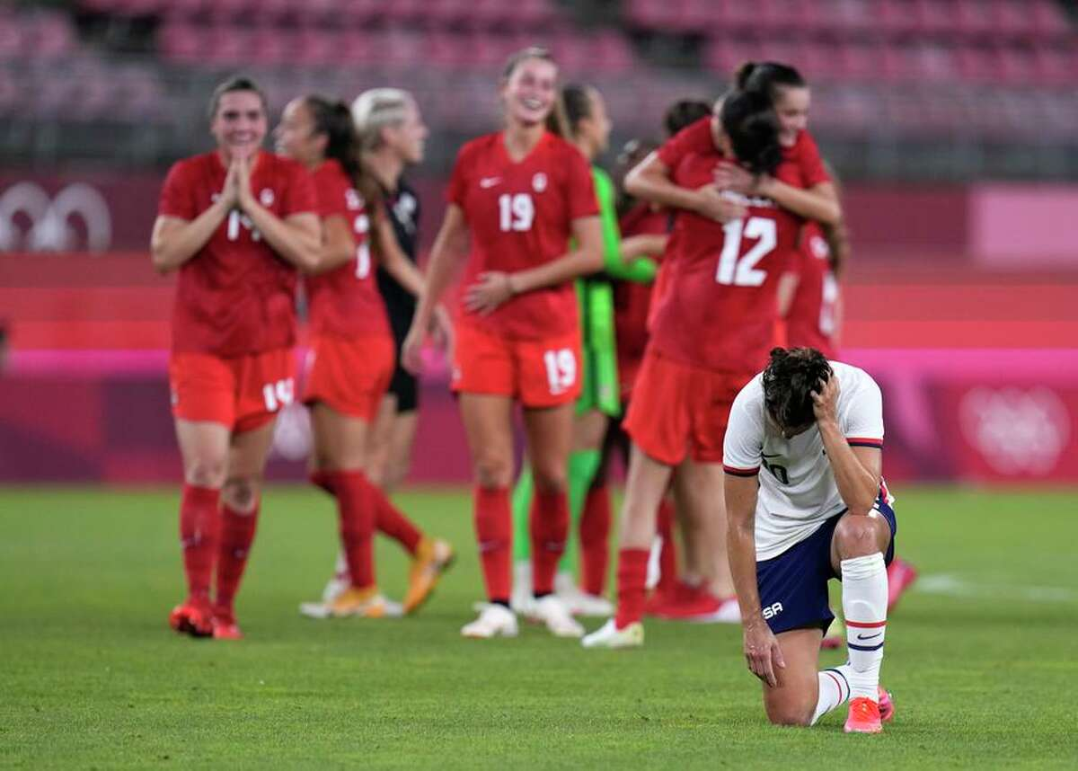 The United States' Carli Lloyd, who came on as a late substitute, reacts after losing to Canada in the semifinal.