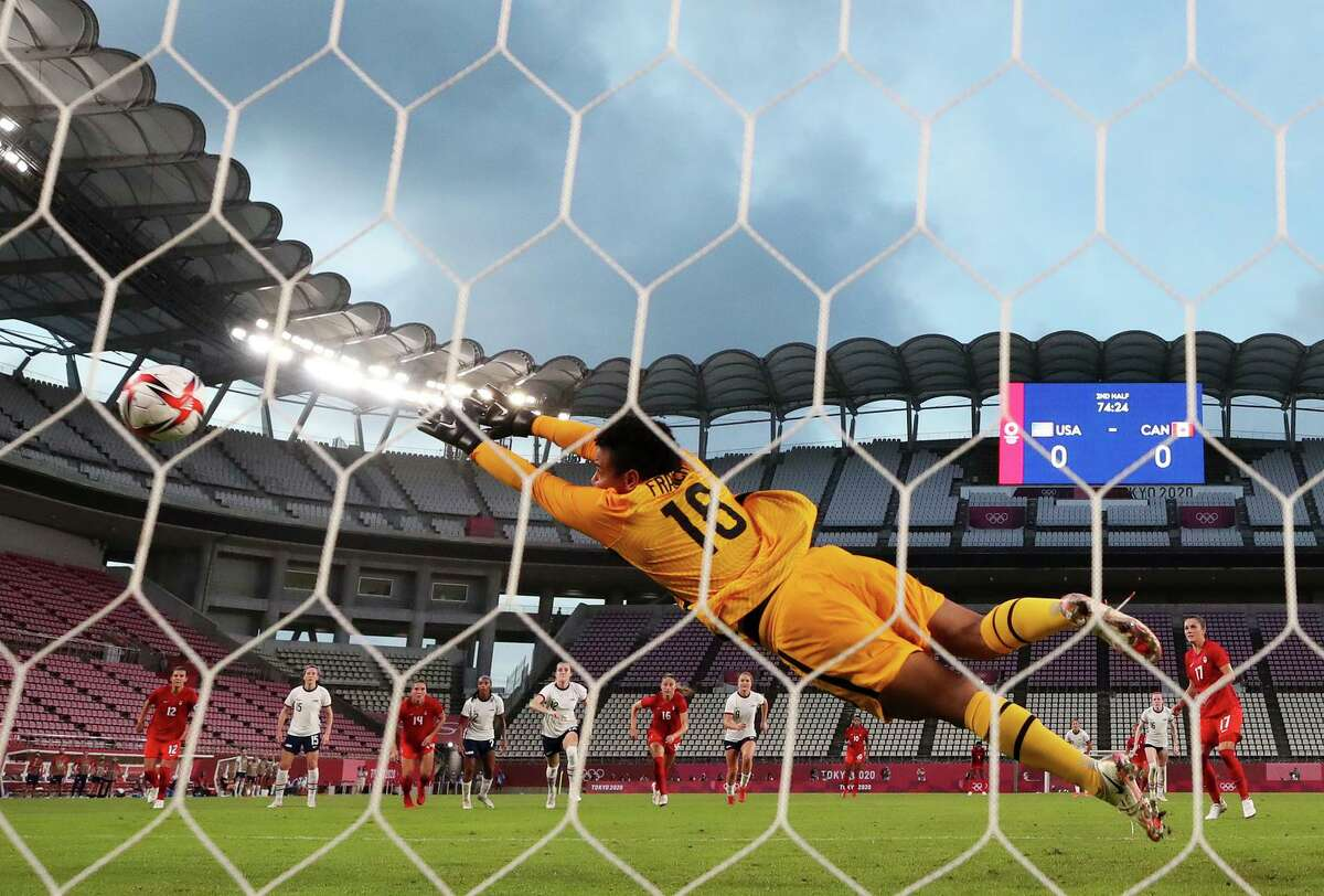 United States goalkeeper Adrianna Franch, who came on to replace injured starter Alyssa Naeher, can't get to Jessie Fleming's penalty kick for Canada, which came in the 75th minute of the semifinal game.