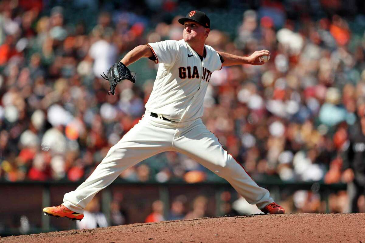 San Francisco Giants' Jake McGee pitches in 9th inning while earning a save in 8-6 win over Houston Astros during MLB game at Oracle Park in San Francisco, Calif., on Saturday, July 31, 2021.