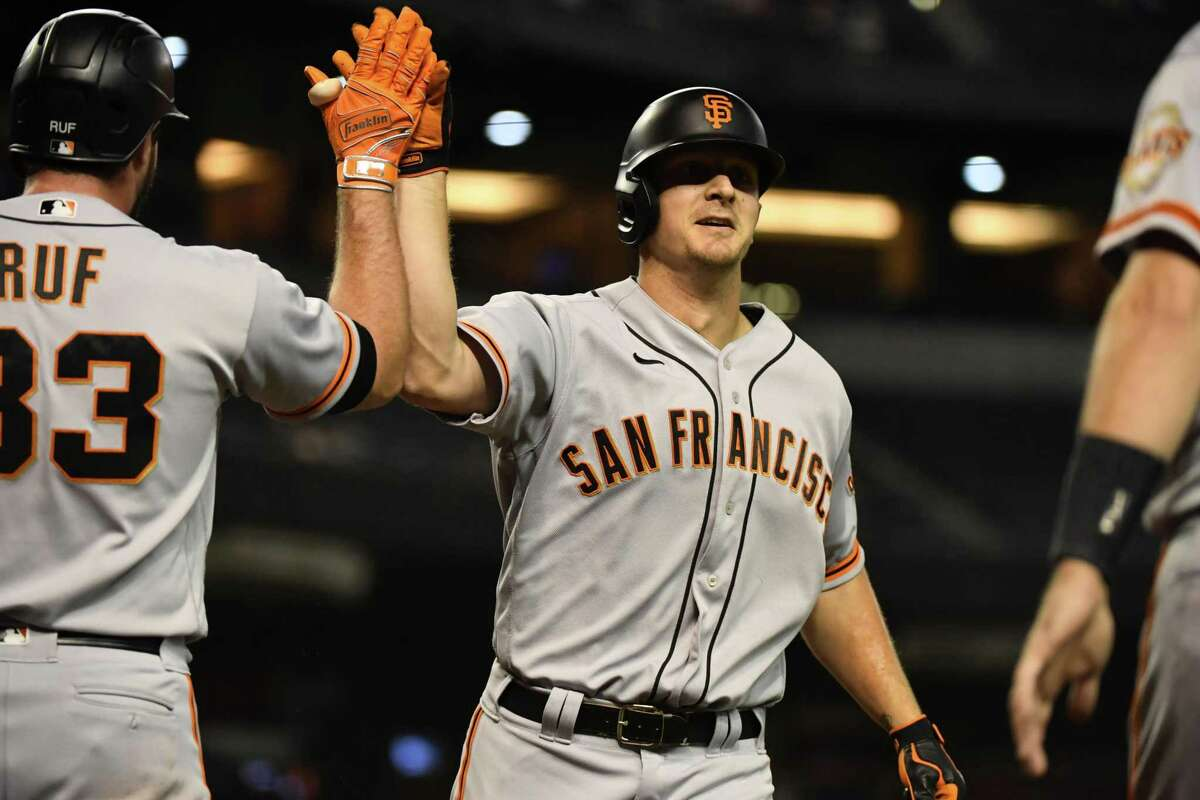 PHOENIX, ARIZONA - AUGUST 02: Alex Dickerson #12 of the San Francisco Giants celebrates with Darin Ruf #33 after hitting a grand slam home run off of JB Bukauskas #33 of the Arizona Diamondbacks during the fifth inning at Chase Field on August 02, 2021 in Phoenix, Arizona. (Photo by Norm Hall/Getty Images)