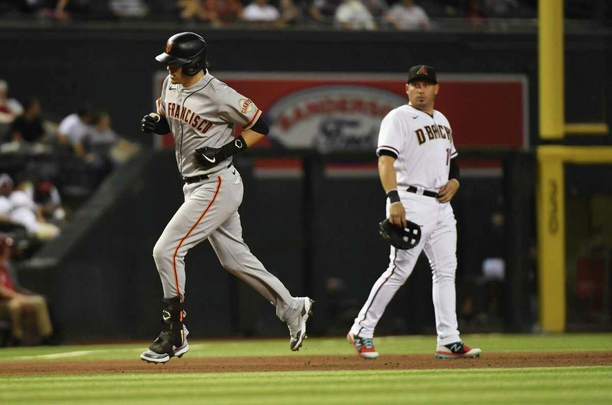 PHOENIX, ARIZONA - AUGUST 02: Wilmer Flores #41 of the San Francisco Giants rounds the bases after hitting a solo home run off of Sean Poppen #64 of the Arizona Diamondbacks during the sixth inning at Chase Field on August 02, 2021 in Phoenix, Arizona. (Photo by Norm Hall/Getty Images)
