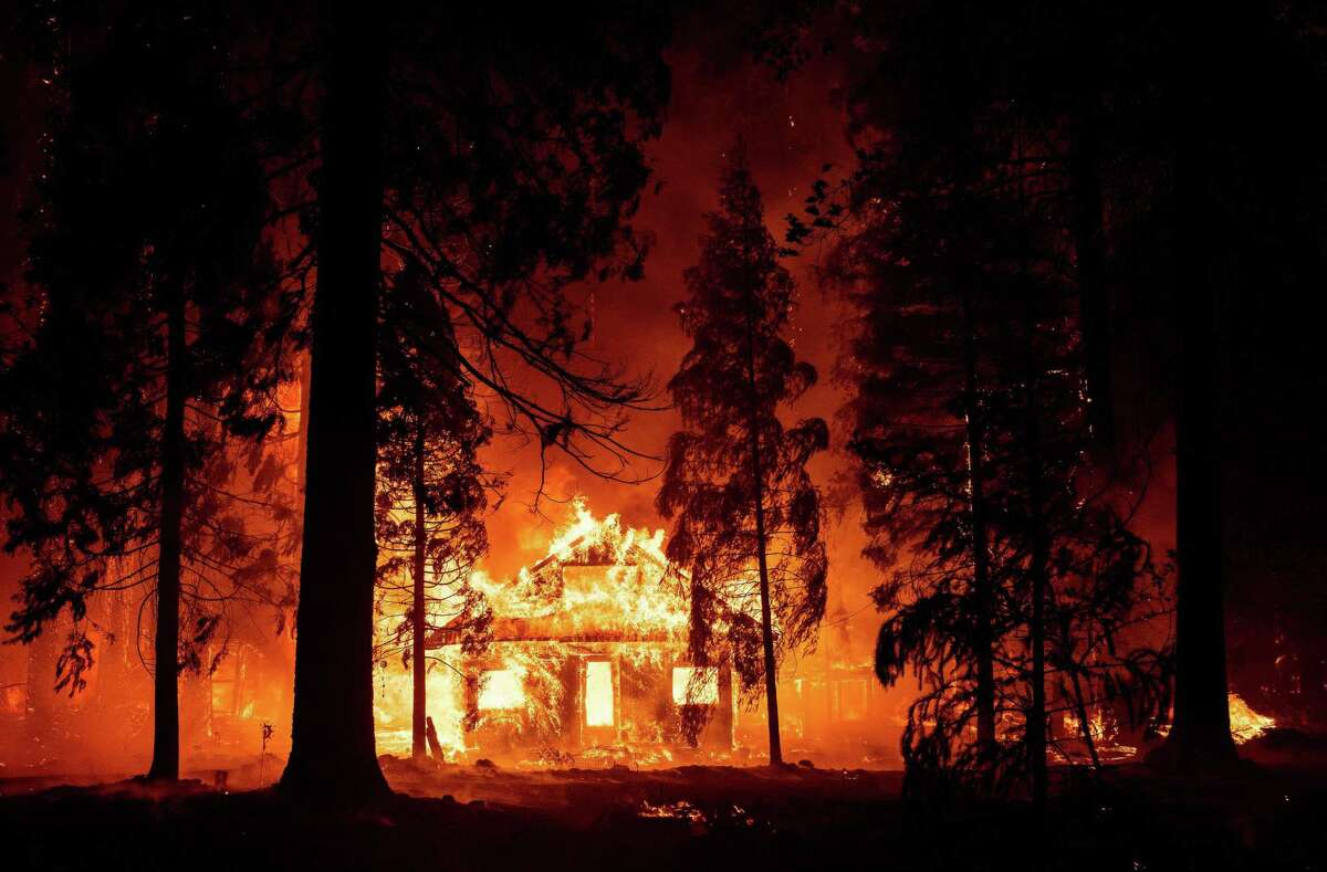 A home burns as the Dixie Fire tears through the Indian Falls neighborhood of unincorporated Plumas County on July 24.