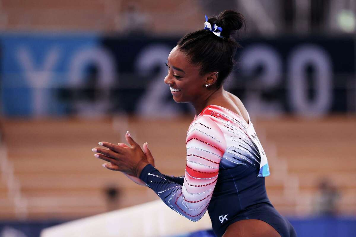 Simone Biles reacts after performance on the balance beam on Tuesday. She won bronze.