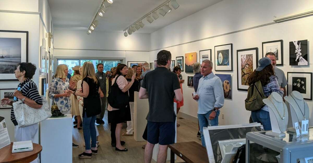 """A new show at the Rowayton Arts Center, (RAC), that is titled: """"Photography and Sculpture,"""" is on view in the center's gallery through Sunday, Aug. 29. The exhibition features over 60 pieces of artwork by area artists. The show opened on Sunday, Aug. 1. Pictured is the inside of the the center of the gallery during the opening of the show."""