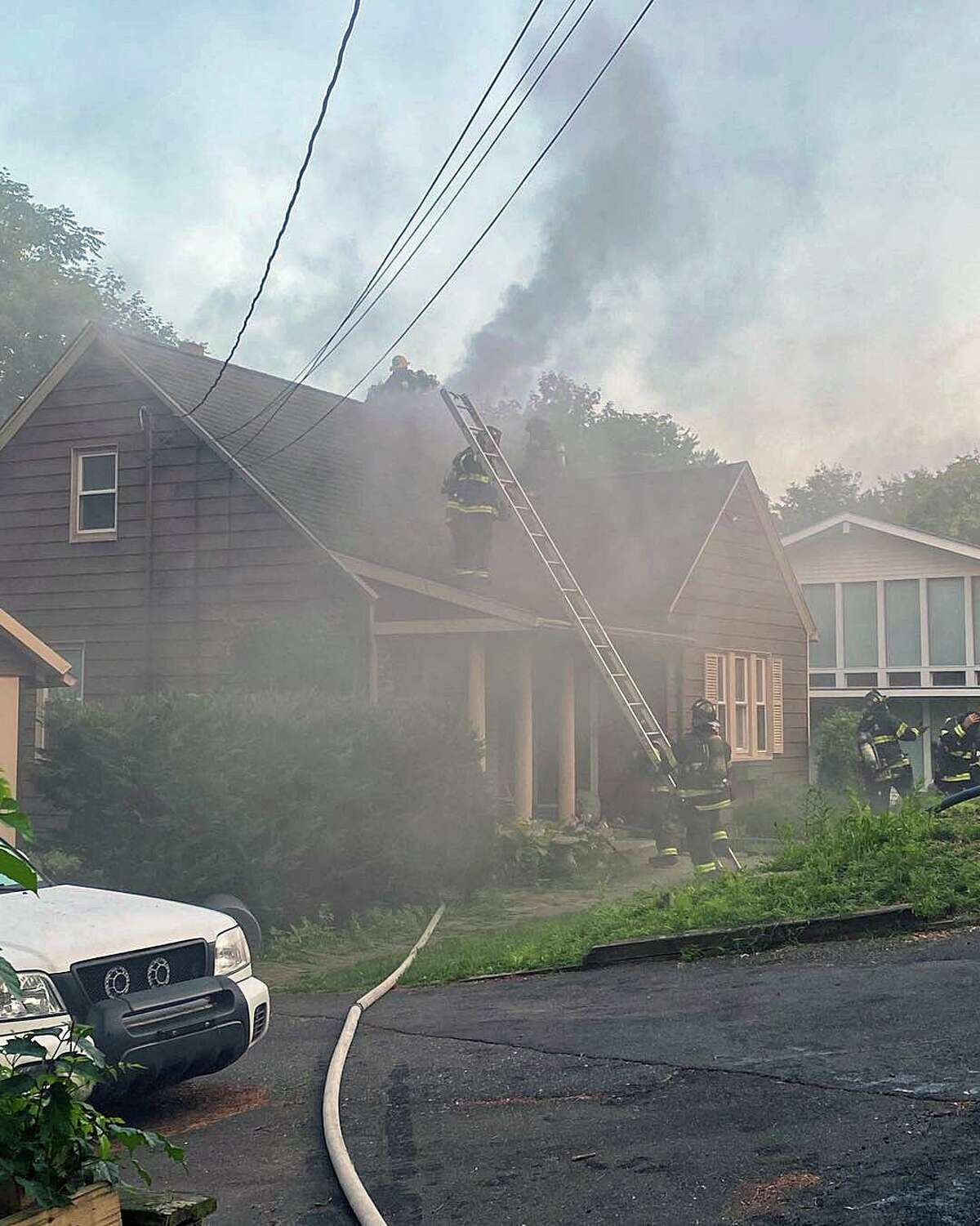 Fire crews reported heavy smoke coming from this Mount Pleasant Street home in Derby, Conn., on Monday, Aug. 2, 2021.