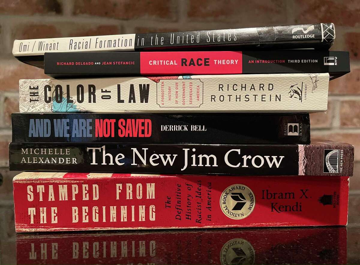 This July 2021 photo shows several of the books commonly assigned in college and law school courses focused on critical race theory.
