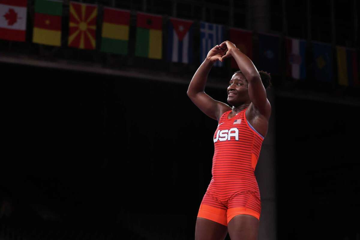 Tamyra Marianna Stock Mensah of Team United States celebrates defeating Blessing Oborududu of Team Nigeria during the Women's Freestyle 68kg Gold Medal Match on day eleven of the Tokyo 2020 Olympic Games at Makuhari Messe Hall on August 03, 2021 in Chiba, Japan.