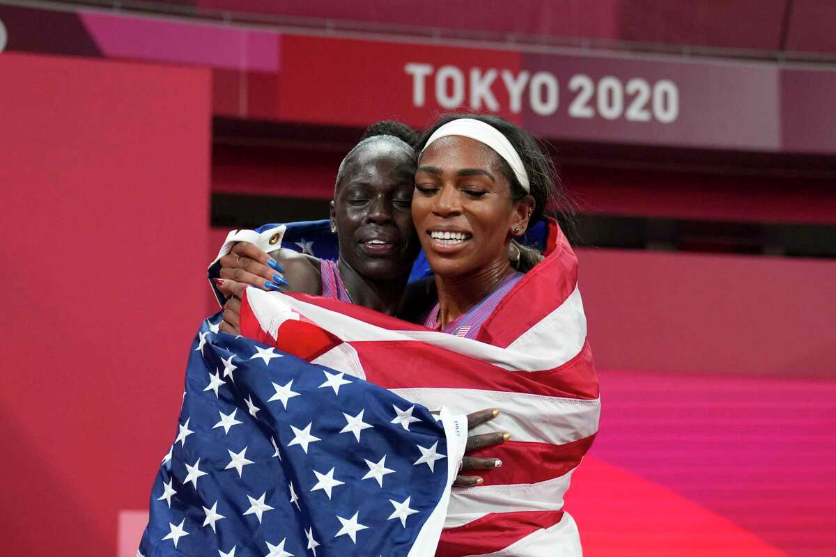 Athing Mu, of the United States, celebrates after winning the gold medal in the women's 800-meter final, with bronze medalist Raevyn Rogers, right, also of the United States, at the 2020 Summer Olympics, Tuesday, Aug. 3, 2021, in Tokyo.