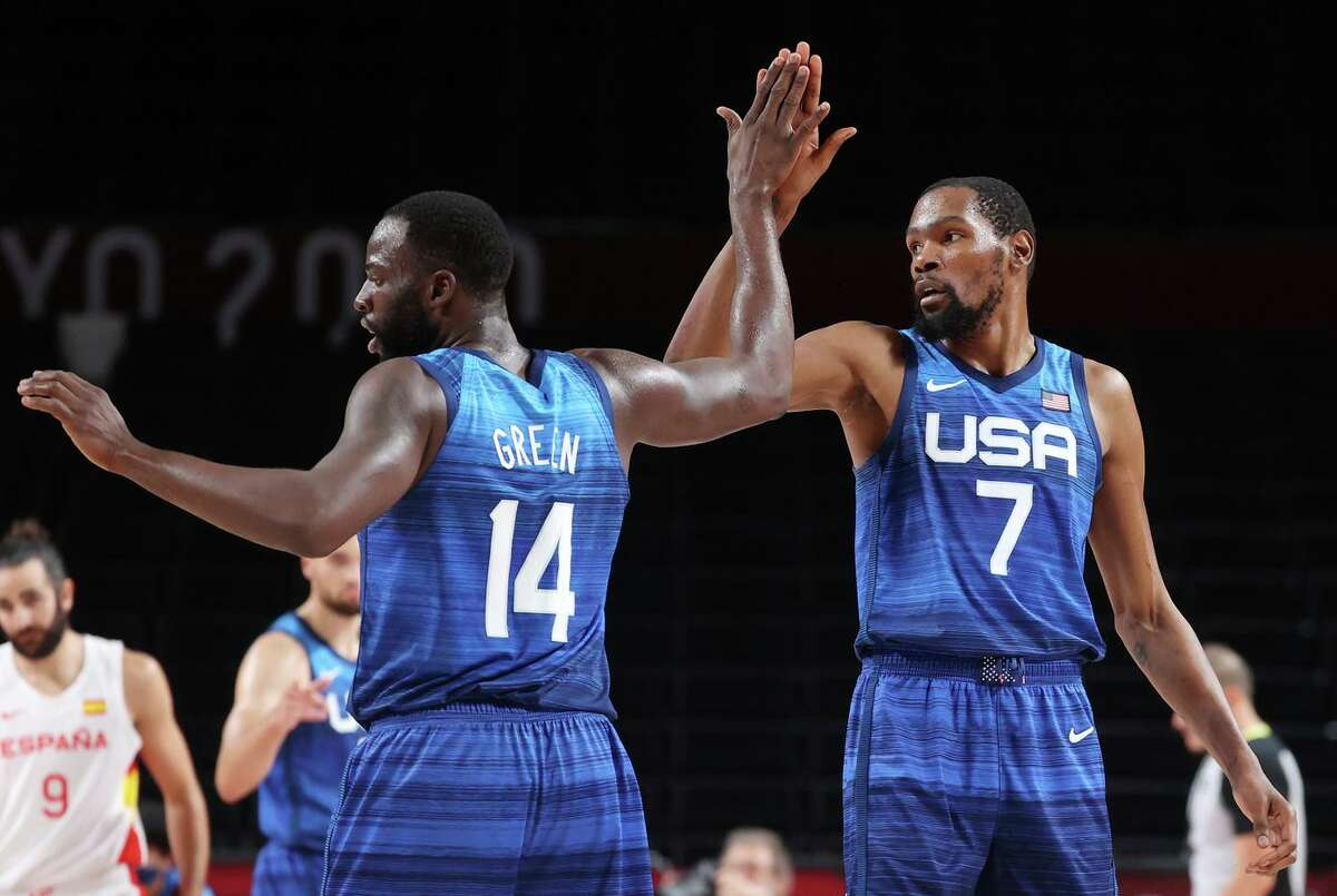 SAITAMA, JAPAN - AUGUST 03: Draymond Green #14 of Team United States high-fives teammate Kevin Durant #7 during the first half of their Men's Basketball Quarterfinal game against Spain on day eleven of the Tokyo 2020 Olympic Games at Saitama Super Arena on August 03, 2021 in Saitama, Japan. (Photo by Gregory Shamus/Getty Images)