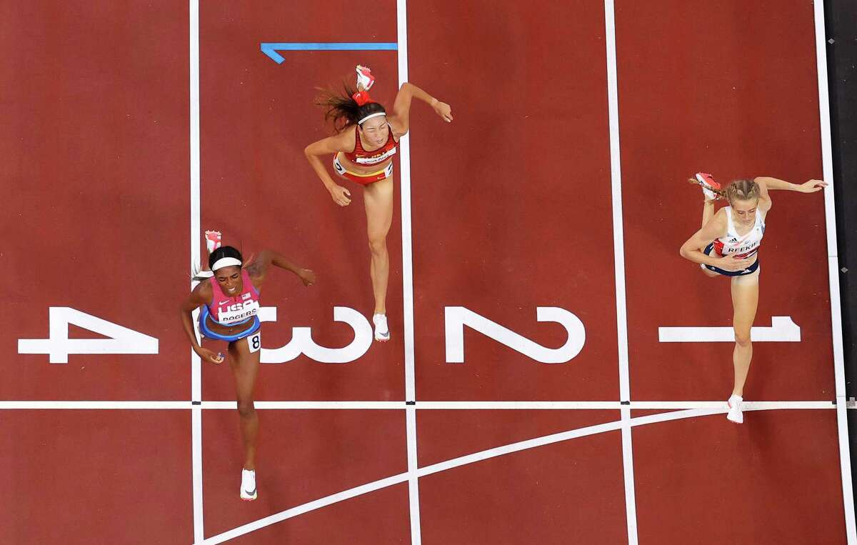Raevyn Rogers of Team United States finishes ahead of Jemma Reekie of Team Great Britain for the bronze medal in the Women's 800m Final on day eleven of the Tokyo 2020 Olympic Games at Olympic Stadium on August 03, 2021 in Tokyo, Japan.