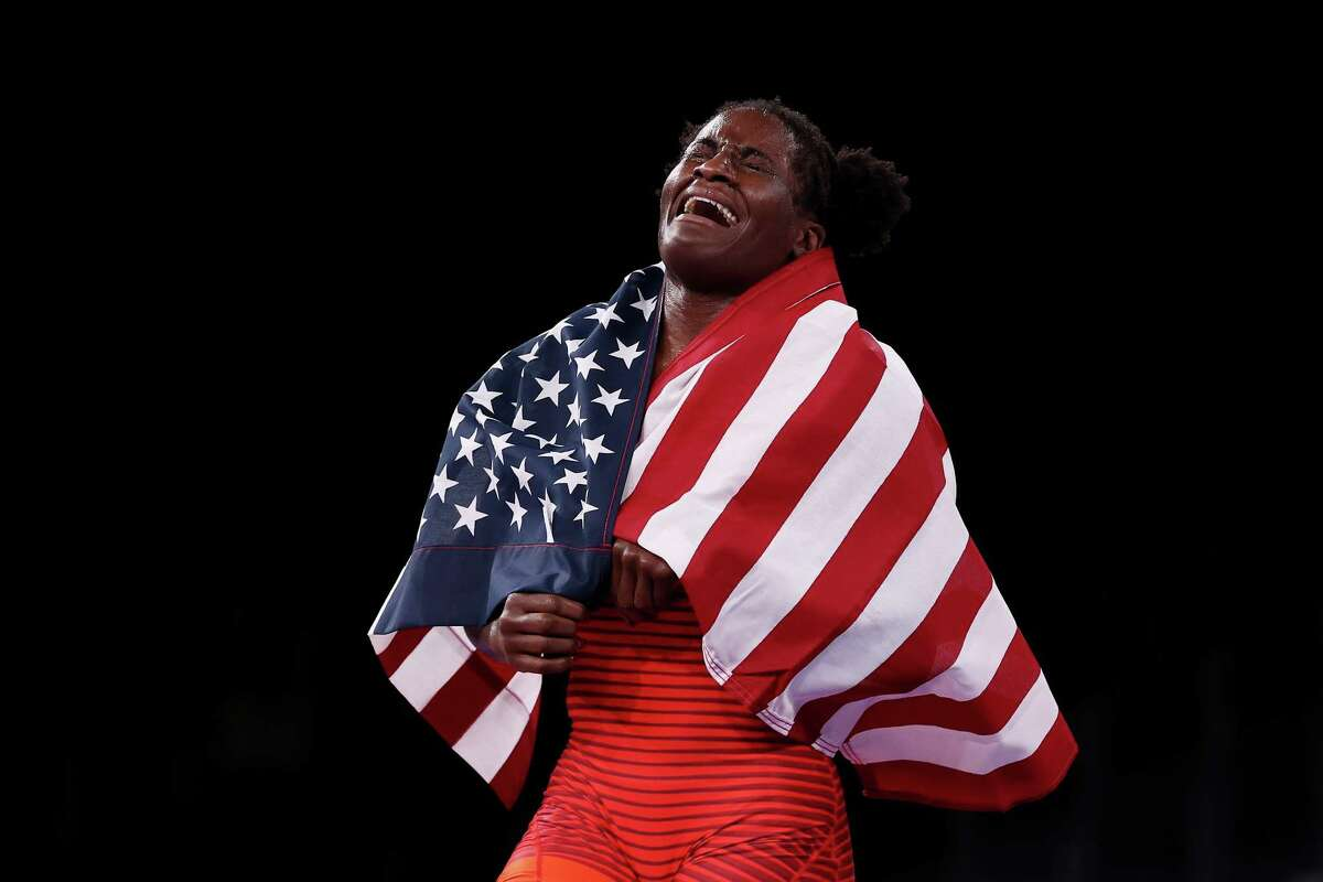 CHIBA, JAPAN - AUGUST 03: Tamyra Marianna Stock Mensah of Team United States celebrates defeating Blessing Oborududu of Team Nigeria during the Women's Freestyle 68kg Gold Medal Match on day eleven of the Tokyo 2020 Olympic Games at Makuhari Messe Hall on August 03, 2021 in Chiba, Japan.