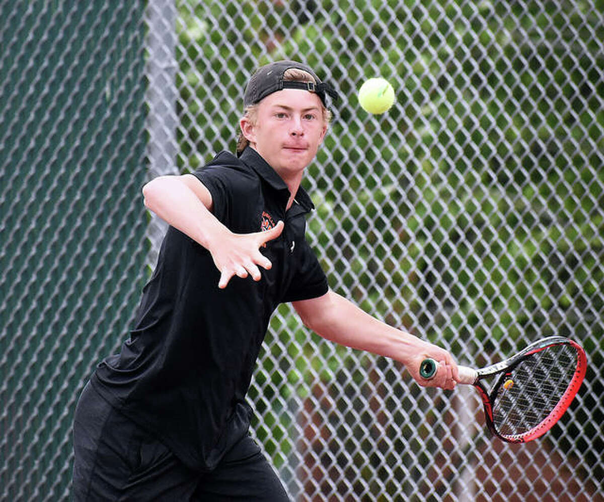 Edwardsville freshman Colton Hulme hits a shot during a No. 1 singles match last season at Edwardsville. Hulme finished with a 34-9 record, including three victories at the state tourney, and is the 2021 Telegraph Boys Tennis Player of the Year.