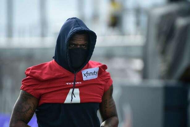 Texans quarterback Deshaun Watson (4) arrives at NFL football practice Monday, Aug. 2, 2021, in Houston. (AP Photo/Justin Rex)