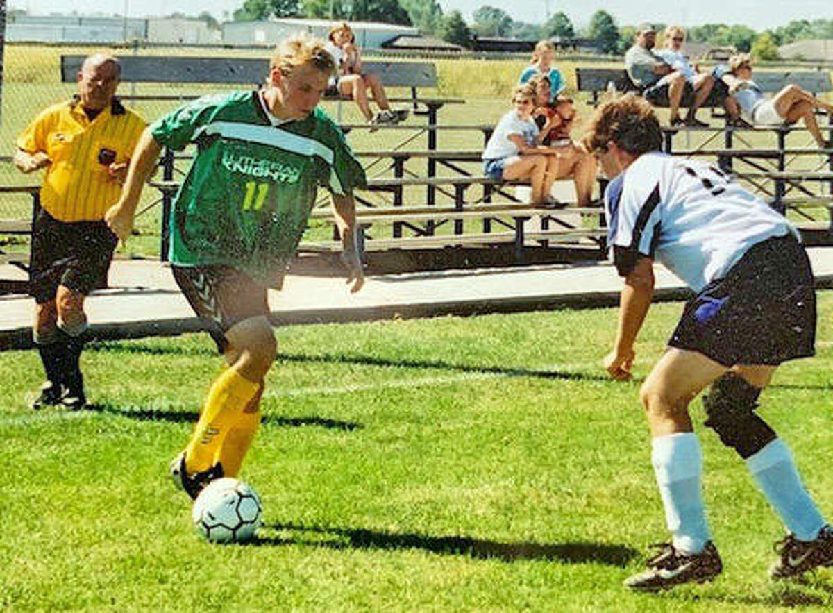 Matt Reeb, left, controls the ball for the Metro-East Lutheran soccer team in 2004.