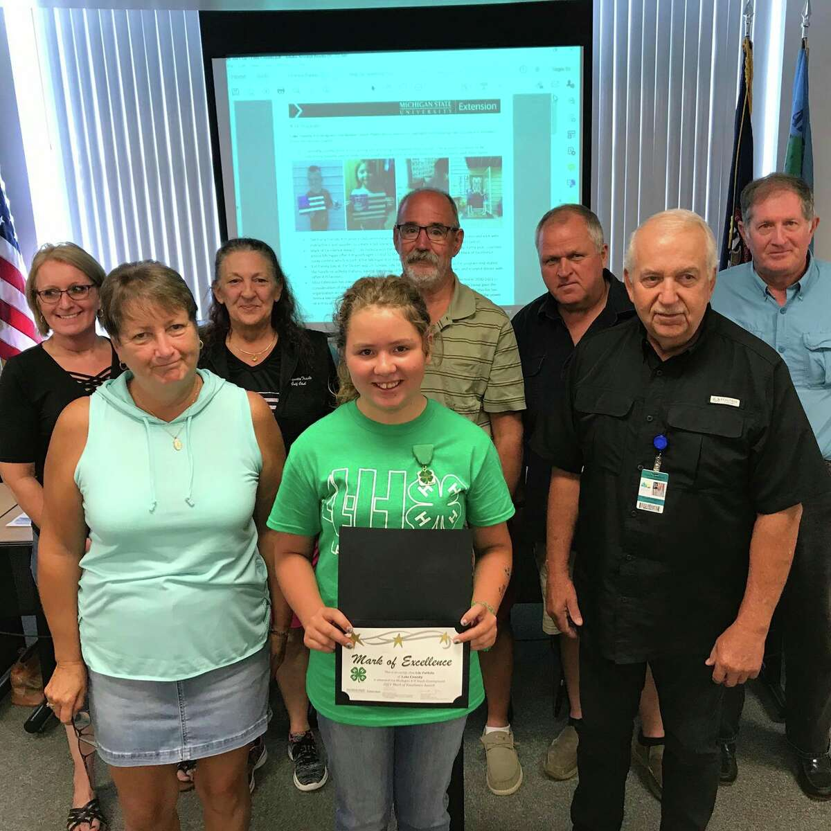Lily Putkela, 12, winner of the 4-H Mark of Excellence Award for Lake County, meets with the Lake County Board of Commissioners to present her essay on what 4-H means to her. Lilyisone of 20 youths throughout the state honored with this 4-H award. (Courtesy/Lake County 4-H)